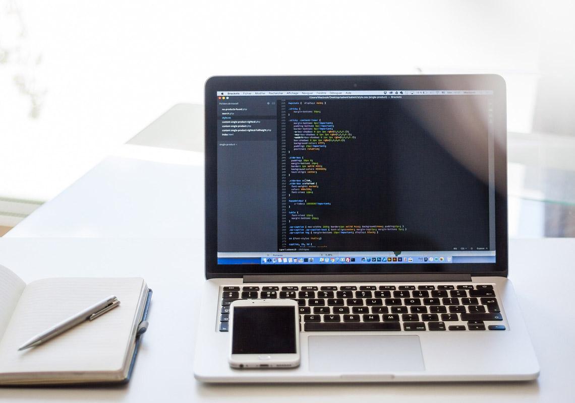 macbook with wordpress code